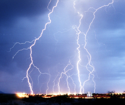 The flow of charge in a lightning bolt ionizes the air, producing the familiar flash.