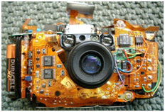 Olympus Stylus camera with skins removed