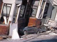 This building in San Francisco sunk into the ground after the 1989 Loma Prieta earthquake. (photo courtesy of NASA)