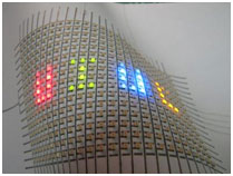A flexible array of LEDs mounted on paper.