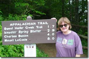Dr. Cizewski standing next to sign for the Appalachian trail.