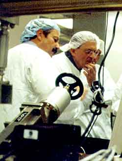 Charles Falco and David Hockney with Molecular Beam Epitaxy machine.
