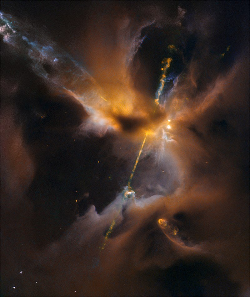 Two narrow jets of highly energized particles erupt from the poles of a nascent star in the constellation Orion