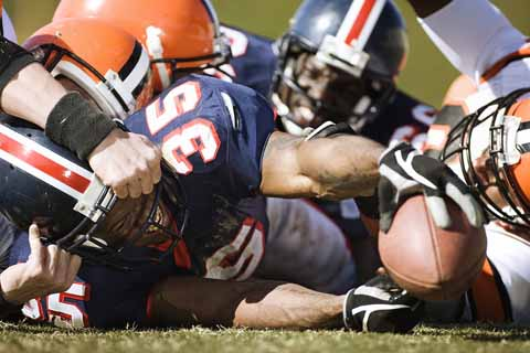Hard tackles like the one shown here can lead to difficult-to-detect brain damage