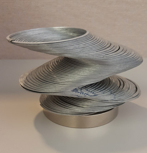 This otherwise-ordinary slinky can be made to hold an unusual shape by the magnet